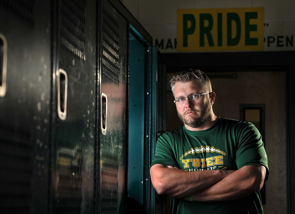 Will.Dickey@jacksonville.com--03/28/16--Yulee High head football coach Bobby Ramsay, photographed in the team locker room Monday, March 28, 2016 in Yulee, Florida. (The Florida Times-Union, Will Dickey)