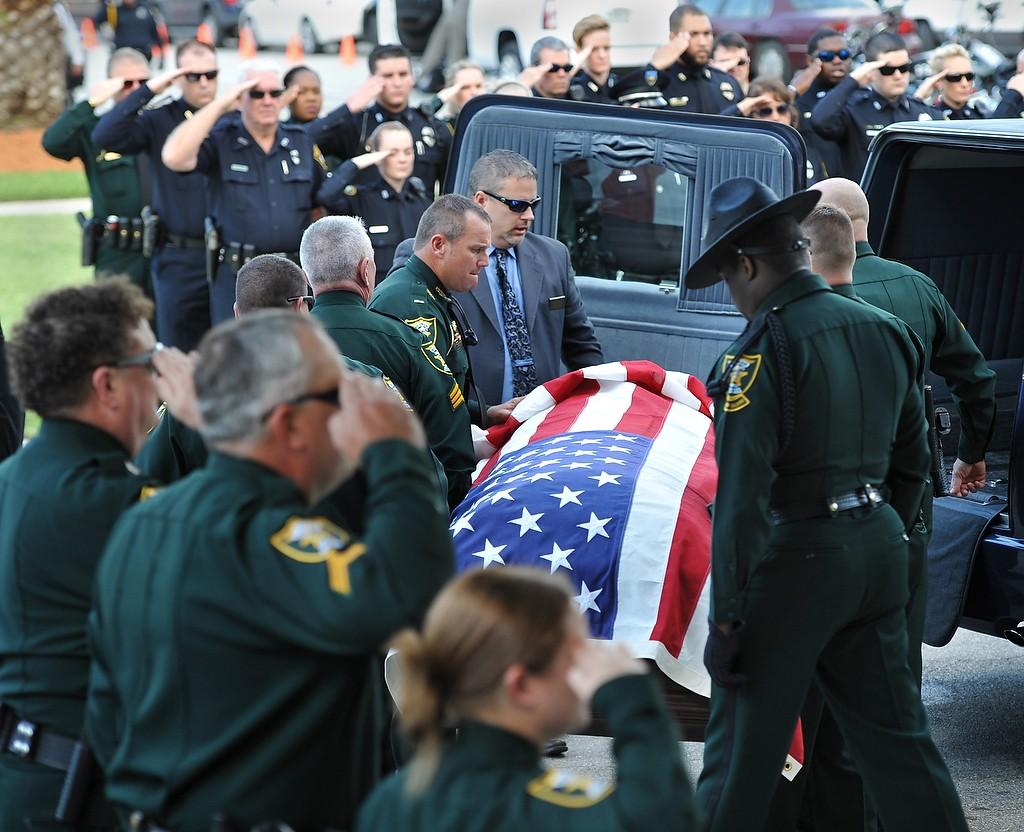 Will.Dickey@jacksonville.com--04/07/16--The coffin of Putnam County Deputy Brandee Smith is loaded into a hearse after her funeral at St. Johns River State College in Palatka, Florida Thursday, April 7, 2016. She died in a boating accident on the St. Johns River. (The Florida Times-Union, Will Dickey)
